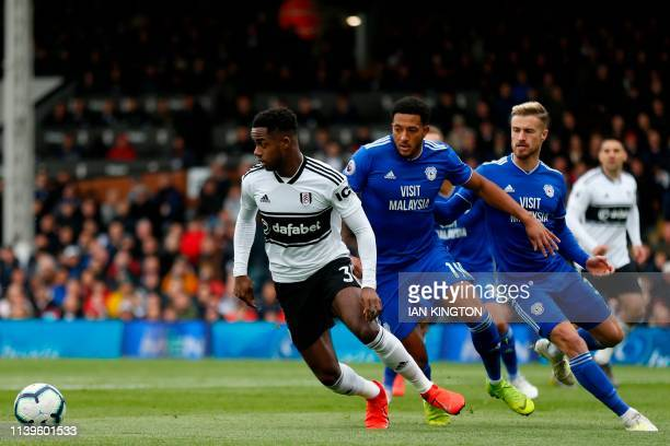 Fulham's English defender Ryan Sessegnon turns away from Cardiff City's English midfielder Nathaniel MendezLaing during the English Premier League...