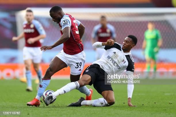 Fulham's English defender Tosin Adarabioyo tackles Aston Villa's English striker Keinan Davis during the English Premier League football match...