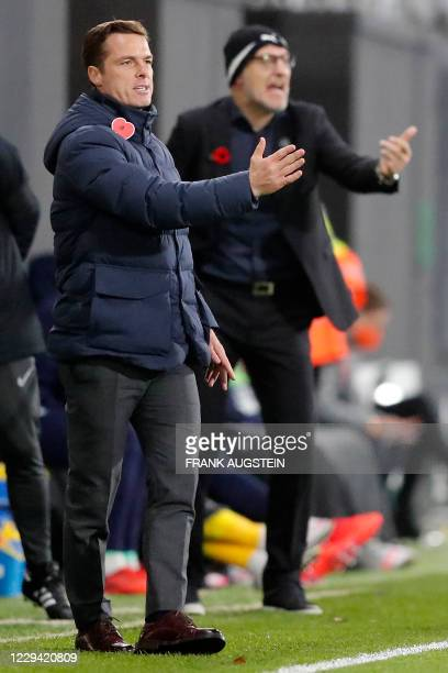 Fulham's English manager Scott Parker and West Bromwich Albion's Croatian head coach Slaven Bilic shouts instructions to his players from the...