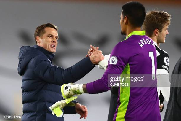 Fulham's English manager Scott Parker congratlulates Fulham's French goalkeeper Alphonse Areola after the English Premier League football match...