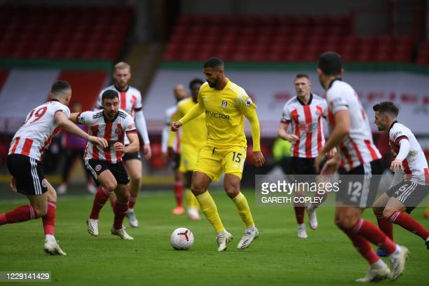 Fulham's English midfielder Ruben Loftus-Cheek becomes the centre of attention during the English Premier League football match between Sheffield...