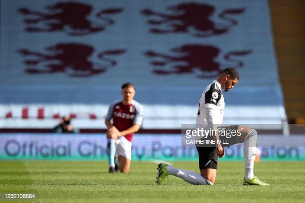 Fulham's English midfielder Ruben Loftus-Cheek takes a knee ahead of the kickoff during the English Premier League football match between Aston Villa...