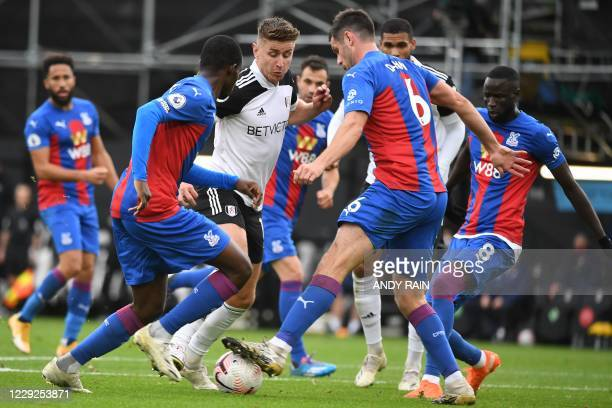 Fulham's English midfielder Tom Cairney tries to break through Fulham defence during the English Premier League football match between Fulham and...