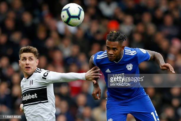 Fulham's English midfielder Tom Cairney vies with Cardiff City's Dutchborn Caracao midfielder Leandro Bacuna during the English Premier League...
