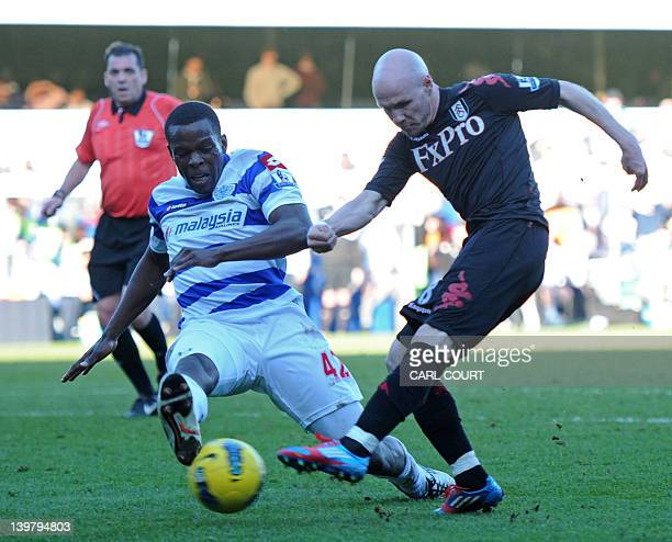 Fulham's English striker Andrew Johnson has a shot blocked by Queens Park Rangers' English defender Nedum Onuoha during the English Premier League...