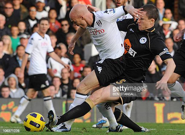 Fulham's English striker Andrew Johnson vies with Wigan Athletic's Scottish defender Gary Caldwell during the English Premier League football match...
