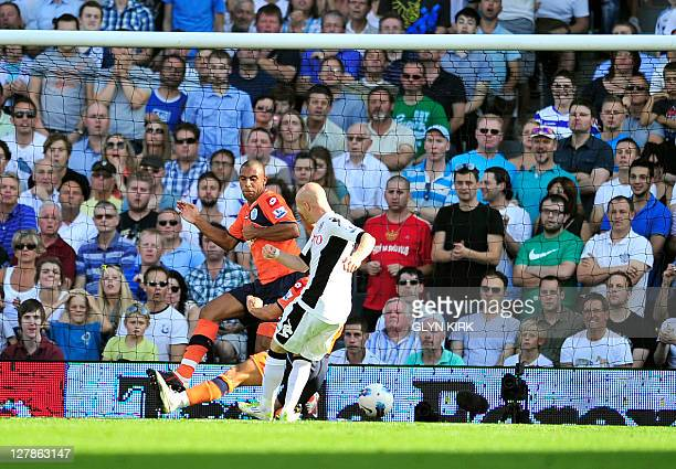 Fulham's English striker Andy Johnson scores the third goal during their English Premier League football match against Queens Park Rangers at Craven...