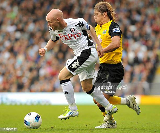 Fulham's English striker Andy Johnson vies for the ball with Blackburn Rovers' Michel Salgado during their Premiership match at Craven Cottage in...