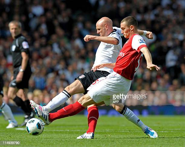 Fulham's English striker Andy Johnson vies with Arsenal's Belgian defender Thomas Vermaelen during the English Premier League football match between...