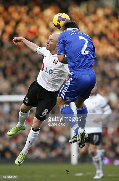 Fulham's English Striker Andy Johnson vies with Chelsea's Serbian Defender Branislav Ivanovic during their Premier League football match at Craven...