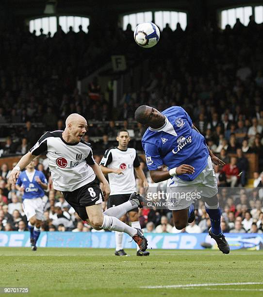 Fulham's English striker Andy Johnson vies with Everton's French defender Sylvain Distin during their Premier League football match against Everton...