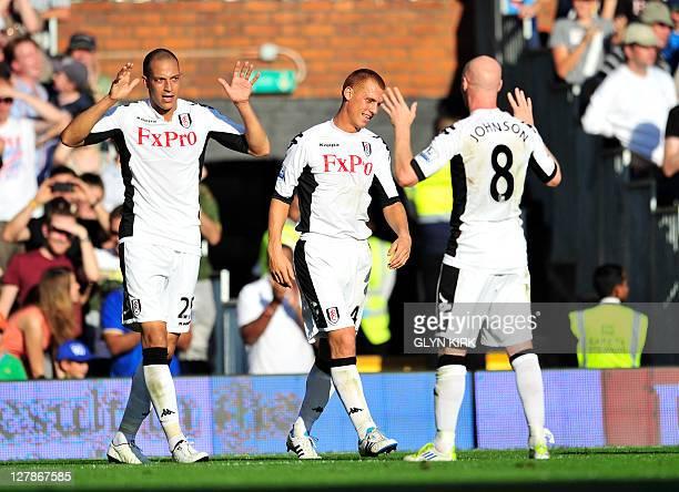 Fulham's English striker Bobby Zamora celebrates scoring a goal with English striker Andy Johnson during the English Premier League football match...