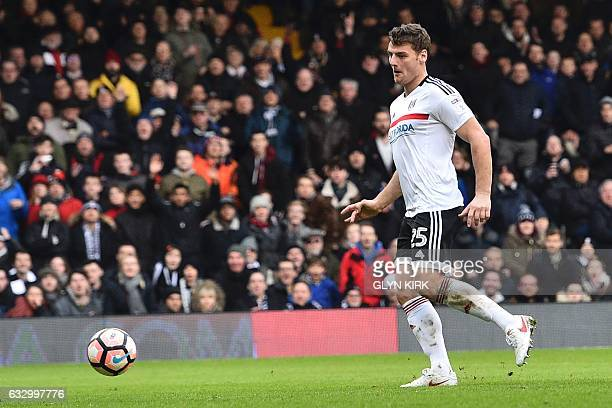 Fulham's English striker Chris Martin scores their second goal during the English FA Cup fourth round football match between Fulham and Hull City at...