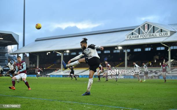 Fulham's English-born Jamaican defender Michael Hector clears the ball during the English FA Cup fourth round football match between Fulham and...