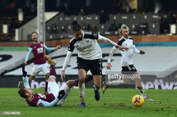Fulham's English-born Jamaican defender Michael Hector fouls Burnley's Czech striker Matej Vydra resulting in a penalty during the English FA Cup...