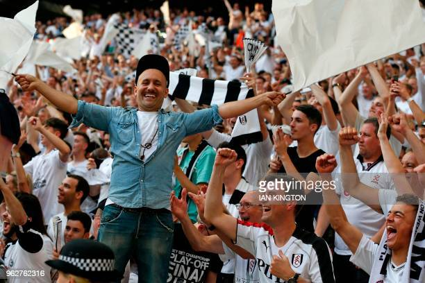 Fulham's fans react to their win after the English Championship playoff final football match between Aston Villa and Fulham at Wembley Stadium in...