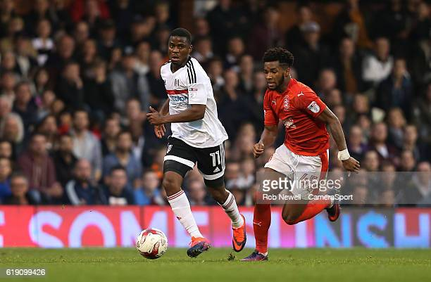 Fulham's Floyd Ayite and Huddersfield Town's Kasey Palmer during the Sky Bet Championship match between Fulham and Huddersfield Town at Craven...