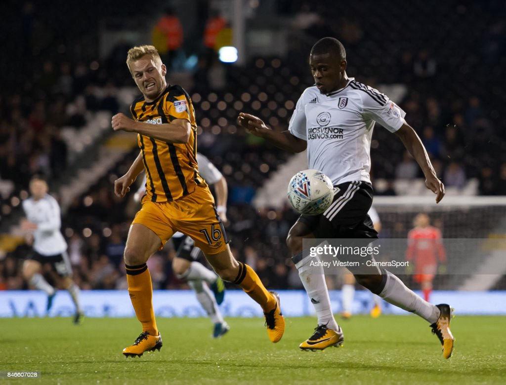 Fulham's Floyd Ayite holds off the challenge from Hull City's Sebastian Larsson during the Sky Bet Championship match between Fulham and Hull City at Craven Cottage on September 13, 2017 in London, England.
