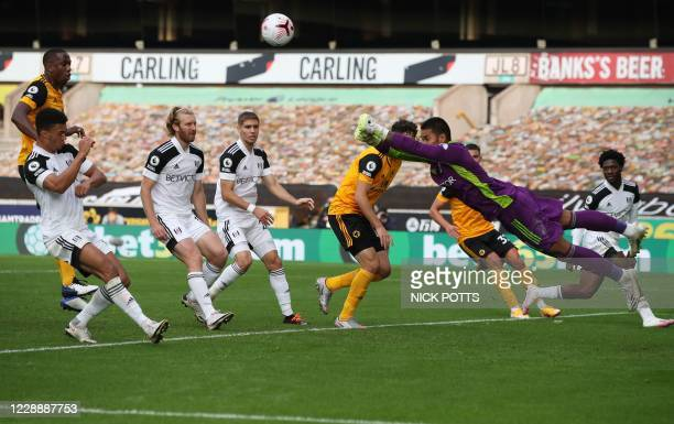 Fulham's French goalkeeper Alphonse Areola makes a save during the English Premier League football match between Wolverhampton Wanderers and Fulham...