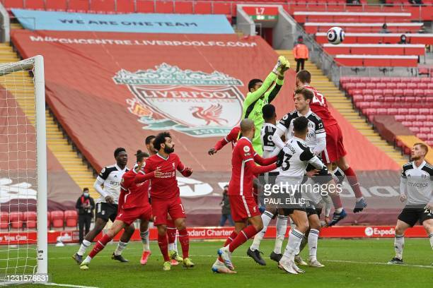 Fulham's French goalkeeper Alphonse Areola punches the ball clear during the English Premier League football match between Liverpool and Fulham at...