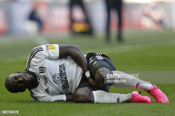 Fulham's French striker Aboubakar Kamara reacts after picking up an injury during the English Championship playoff final football match between Aston...