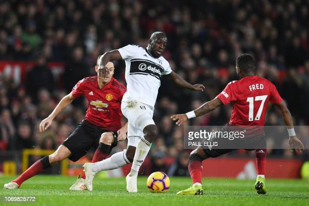 Fulham's French striker Aboubakar Kamara vies with Manchester United's Brazilian midfielder Fred during the English Premier League football match...