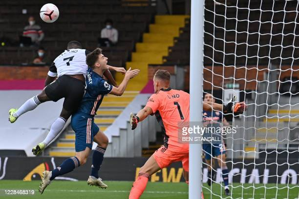 Fulham's Frenchborn Congolese midfielder Neeskens Kebano jumps for a crossed ball as Arsenal's Scottish defender Kieran Tierney defends during the...