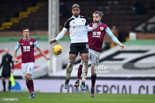 Fulham's Gabonese midfielder Mario Lemina vies for the ball against Burnley's English striker Jay Rodriguez during the English FA Cup fourth round...