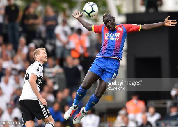 TOPSHOT Fulham's German midfielder Andre Schurrle vies with Crystal Palace's French midfielder Mamadou Sakho during the English Premier League...