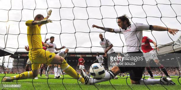 Fulham's Goalkeeper David Stockdale and Johnathan Greening fail to stop a goal by Manchester United's Nani during their Premiership football match at...