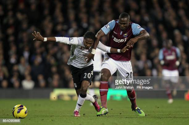 Fulham's Hugo Rodallega and West Ham United's Guy Demel battle for the ball during the Barclays Premier League match at Craven Cottage London