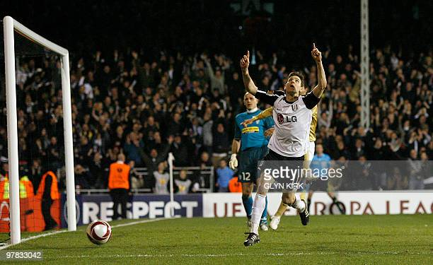 Fulham's Hungarian midfielder Zoltan Gera celebrates scoring a penalty during their UEFA Europa League round of 16 second leg football match against...