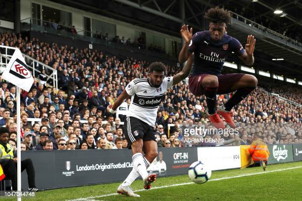 TOPSHOT Fulham's Irish defender Cyrus Christie vies with Arsenal's English striker Danny Welbeck during the English Premier League football match...
