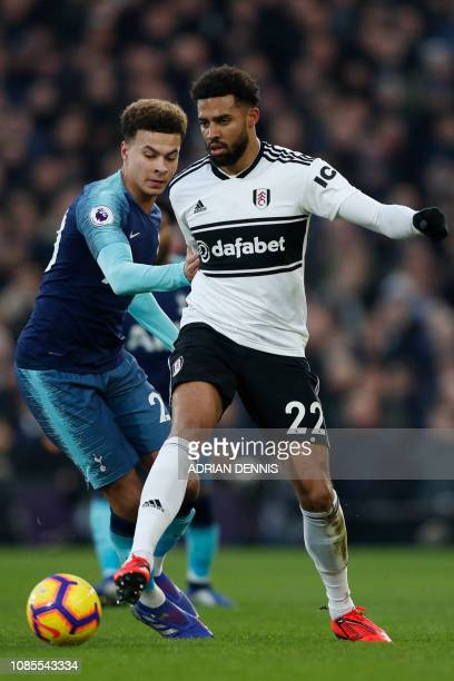 Fulham's Irish defender Cyrus Christie vies with Tottenham Hotspur's English midfielder Dele Alli during the English Premier League football match...