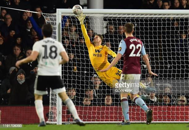 Fulham's Irish midfielder Harry Arter watches as his shot beats the dive of Aston Villa's Norwegian goalkeeper Orjan Nyland for their second goal...