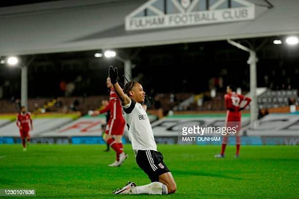 Fulham's Jamaican striker Bobby Decordova-Reid celebrates after scoring the opening goal of the English Premier League football match between Fulham...