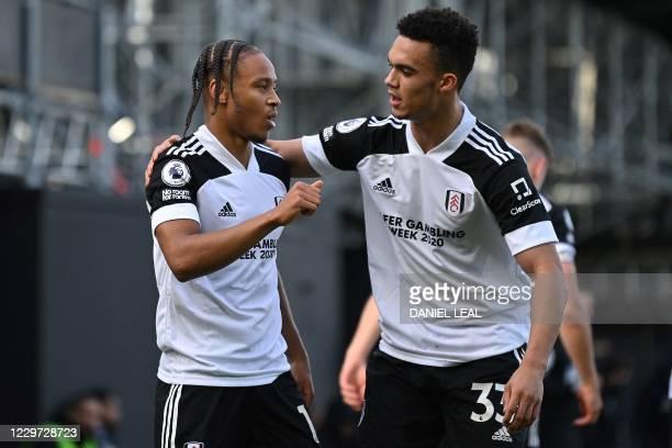 Fulham's Jamaican striker Bobby Decordova-Reid celebrates with Fulham's English-born US defender Antonee Robinson after scoring the equalising goal...
