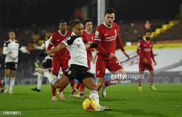 Fulham's Jamaican striker Bobby Decordova-Reid shoots to score the opening goal of the English Premier League football match between Fulham and...