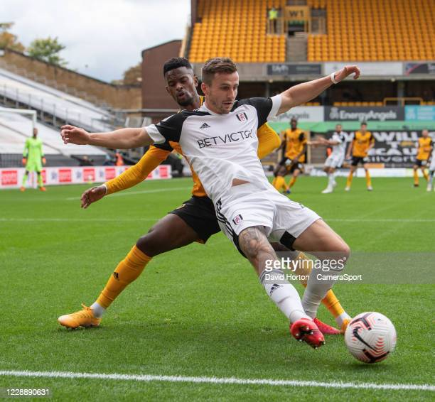 Fulhams Joe Bryan is tackled from behind by Wolverhampton Wanderers' Nelson Semedo during the Premier League match between Wolverhampton Wanderers...