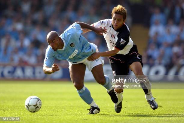 Fulham's Junichi Inamoto lunges in with a challenge to try and stop Manchester City's Trevor Sinclair