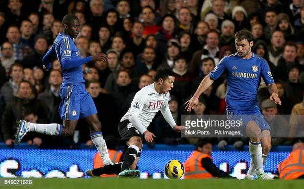 Fulham's Kerim Frei falls in the area under the challenge from Chelsea's Ramires