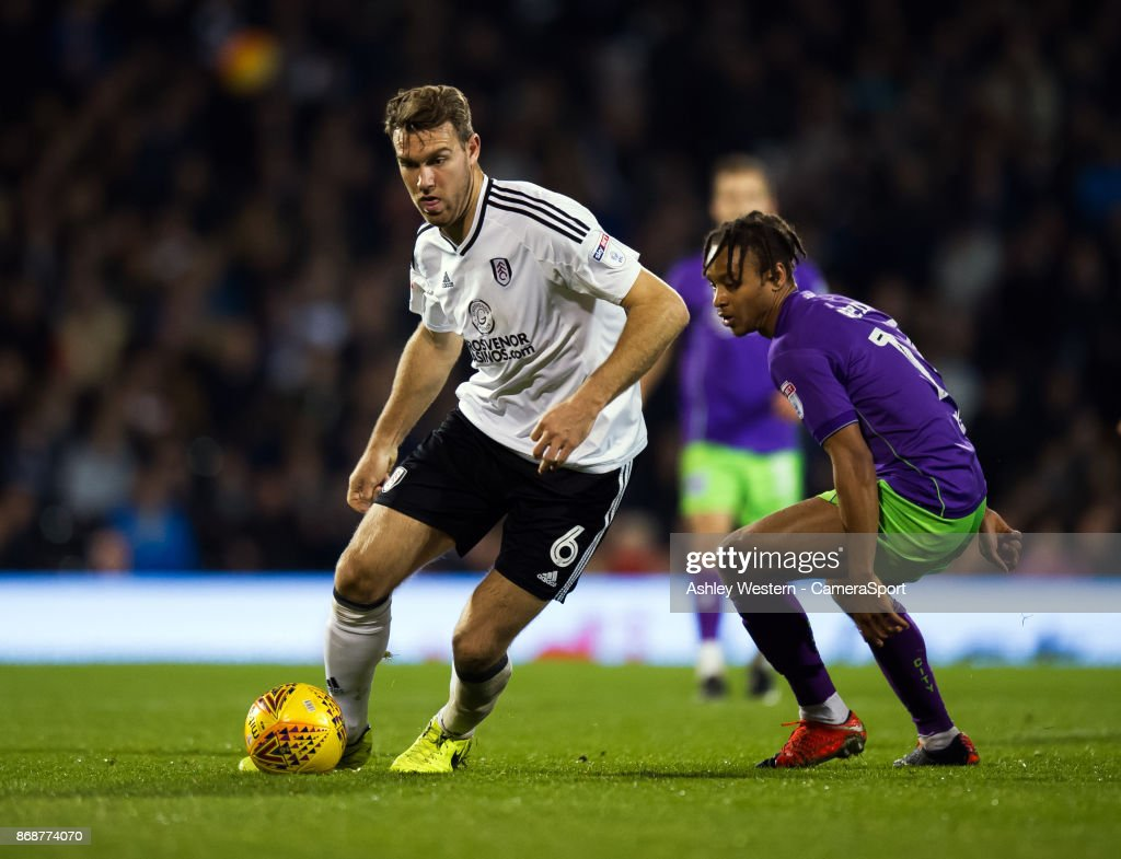 Fulham's Kevin McDonald holds off the challenge from Bristol City's Bobby Reid during the Sky Bet Championship match between Fulham and Bristol City at Craven Cottage on October 31, 2017 in London, England.