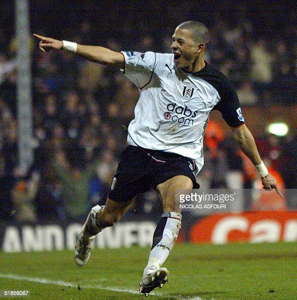 Fulham's Liam Rosenior celebrates the equaliser scored by Papa Boupa Diop at Fulham football club in London 13 December 2004 during the Premiership...