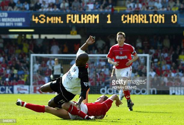 Fulham's Luis Boa Morte goes down from a challenge from Luke Young of Charlton during a Premiership football match at Loftus Road in London 24 April...