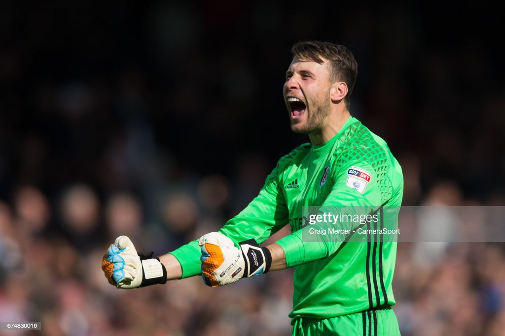 Fulham's Marcus Bettinelli celebrates at full time of the Sky Bet Championship match between Fulham and Brentford at Craven Cottage on April 29, 2017 in London, England.