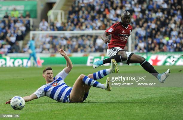 Fulham's Neeskens Kebano is tackled by Reading's George Evans Sky Bet Championship PlayOff Semi Final Second Leg match between Reading and Fulham at...