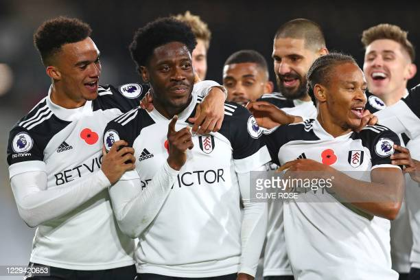Fulham's Nigerian defender Ola Aina celebrates scoring his team's second goal during the English Premier League football match between Fulham and...
