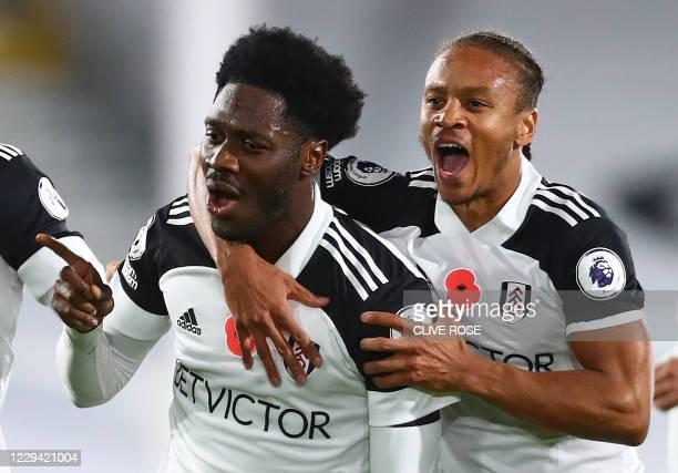 Fulham's Nigerian defender Ola Aina celebrates scoring his team's second goal with Fulham's Jamaican striker Bobby Decordova-Reid during the English...