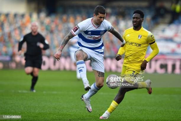 Fulham's Nigerian defender Ola Aina vies with Queens Park Rangers' Scottish striker Lyndon Dykes during the English FA Cup third round football match...