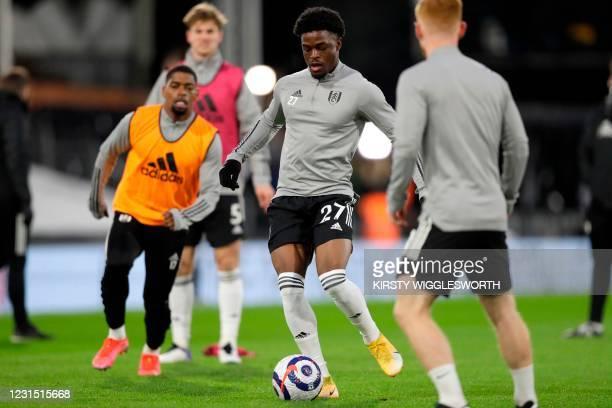 Fulham's Nigerian striker Josh Maja warms up ahead of the English Premier League football match between Fulham and Tottenham Hotspur at Craven...